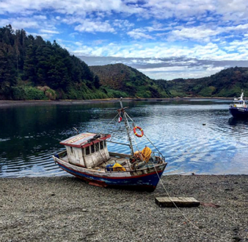 Fishing Boat by the Water. Photo Credit: Michael McKee.