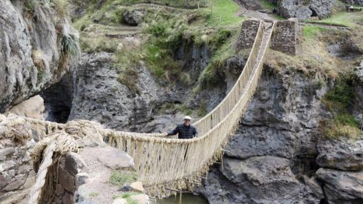 Qeswachaka (Quechua bridge in Quechua) Traditional grass rope bridge near Cuzco, Peru. Photo credit: Devin Grammon